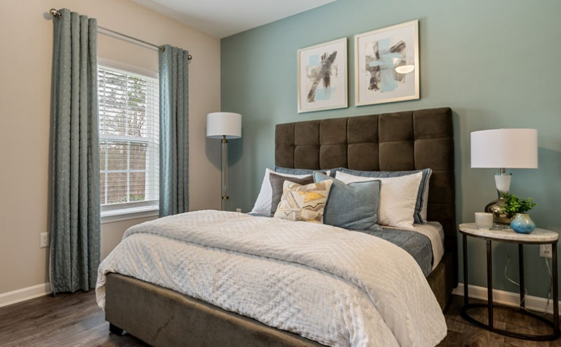 large windows brighten spacious bedroom