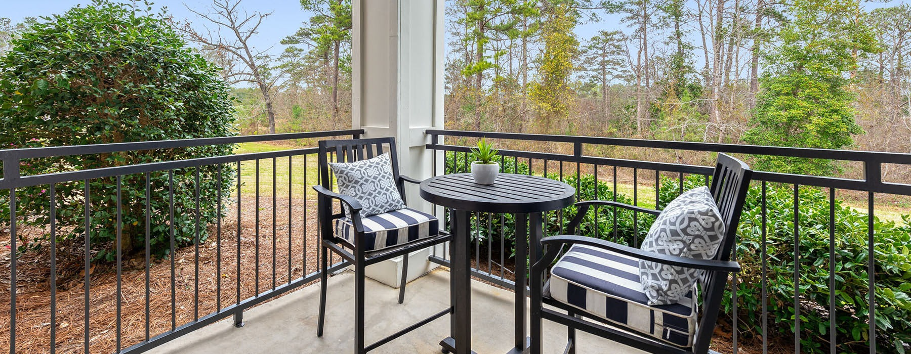 furnished patio with railings and nature views